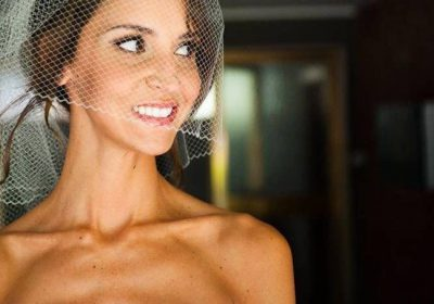 Smiling bride with a veil